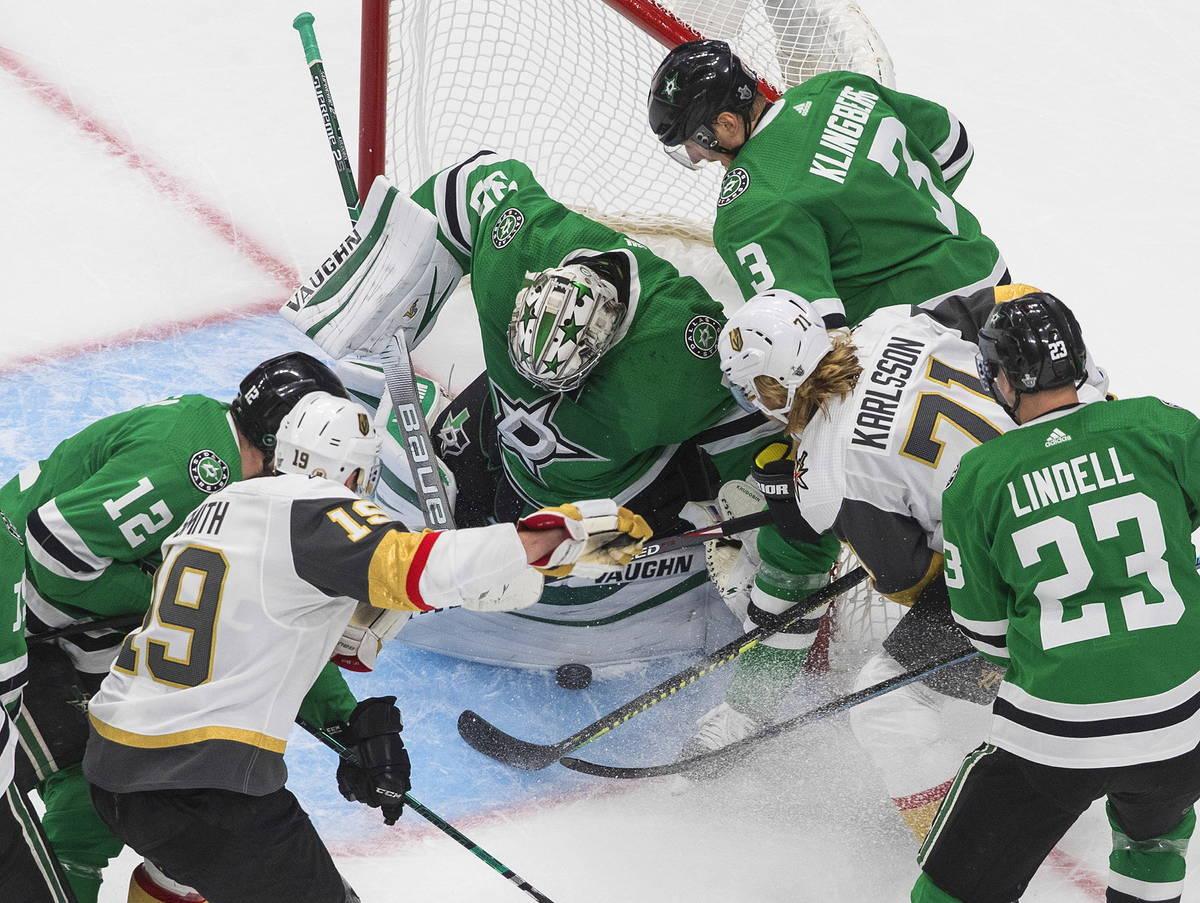 Dallas Stars goalie Anton Khudobin (35) makes a save on Vegas Golden Knights' William Karlsson ...