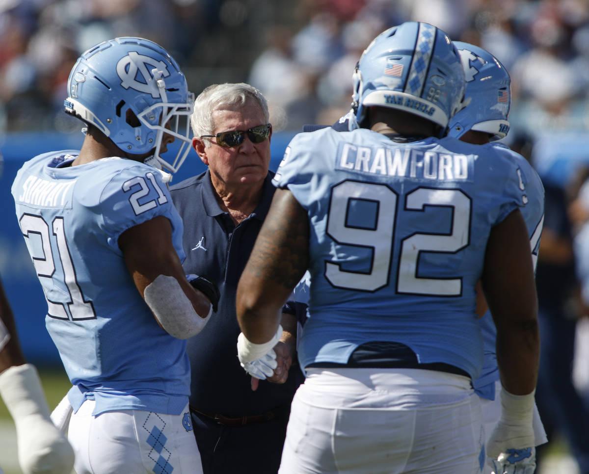 In this Aug. 31, 2019, file photo, North Carolina head coach Mack Brown talks to linebacker Cha ...