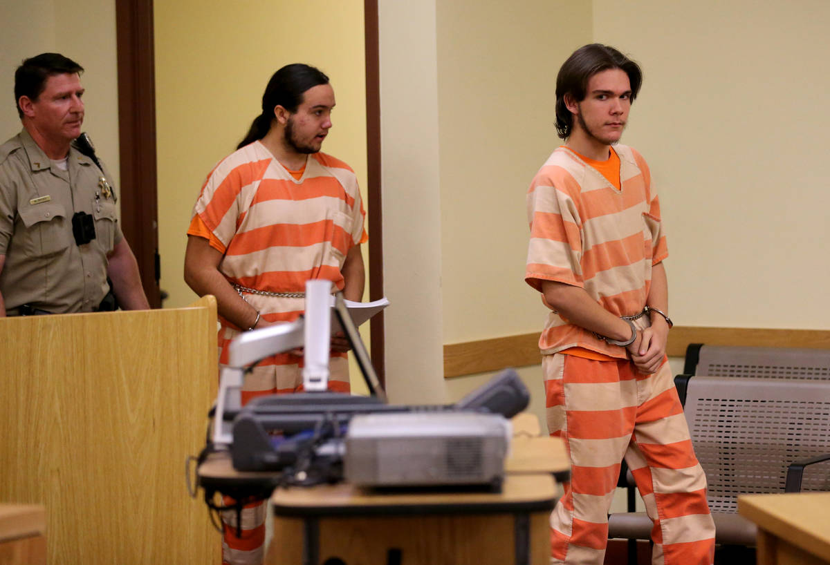 Brothers Michael Wilson, right, and Dakota Saldivar arrive in the courtroom for a preliminary h ...