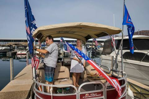 Larry Silvestri, left, and his wife Mary attach 20 flags to their boat while preparing for the ...