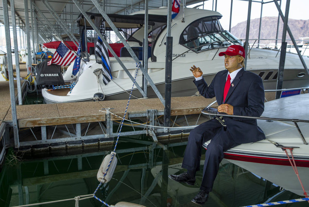 A President Donald Trump mannequin sits on the bow of a boat with others in preparation for the ...