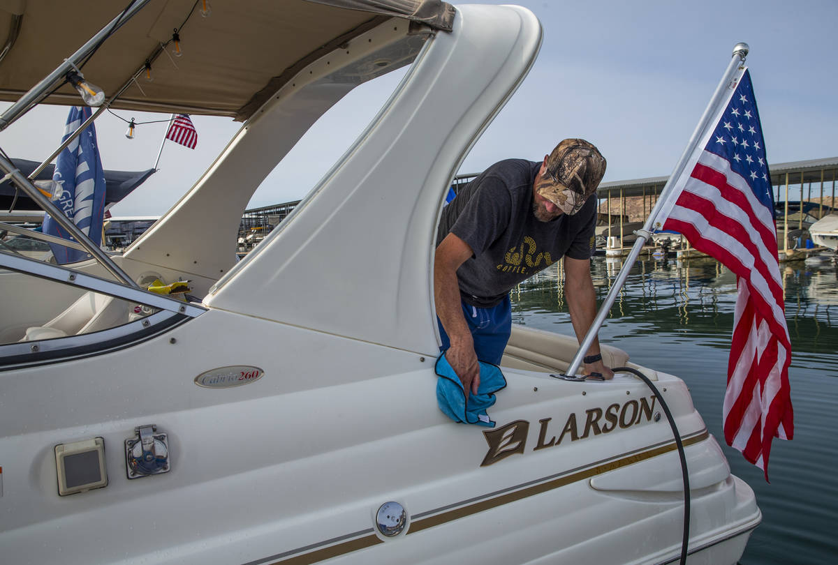 Anthony Carlo spruces up his boat while preparing for the President Donald Trump boat parade Sa ...