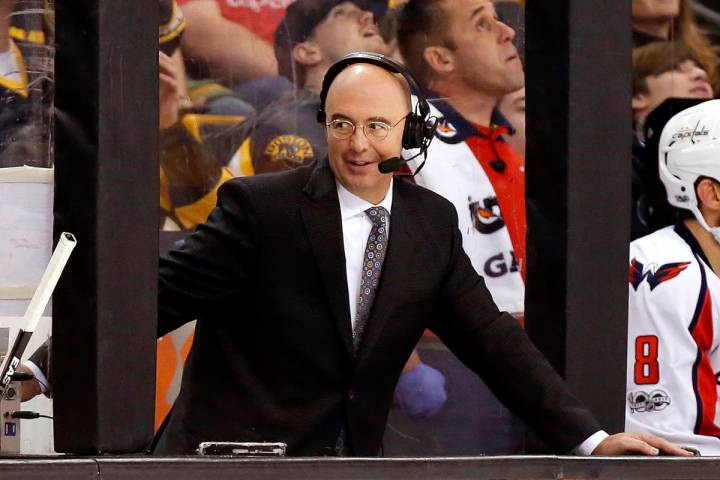 FILE- In this April 8, 2017, file photo, Pierre McGuire broadcasts from between the benches dur ...