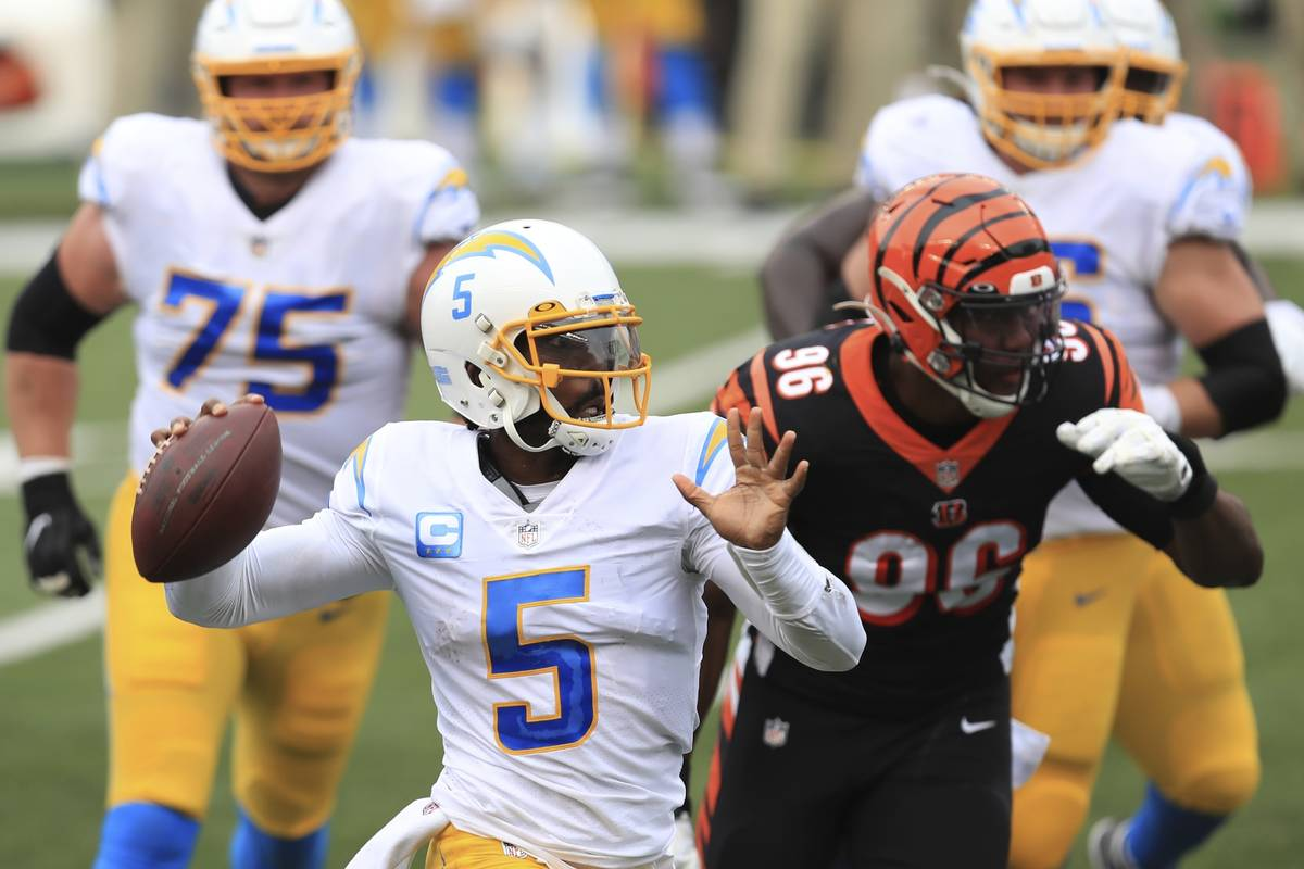 Los Angeles Chargers quarterback Tyrod Taylor (5) throws during the first half of an NFL footba ...