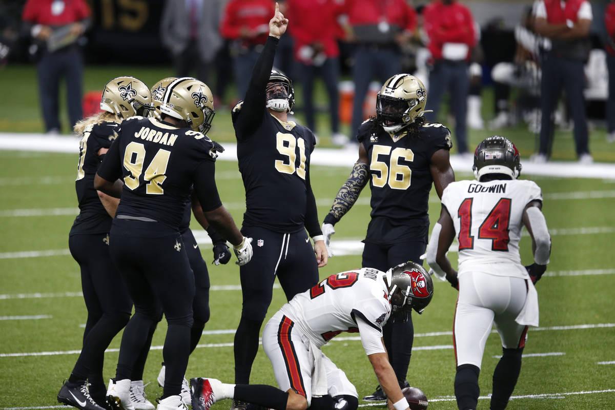 New Orleans Saints defensive end Trey Hendrickson (91) celebrates with teammates after sacking ...
