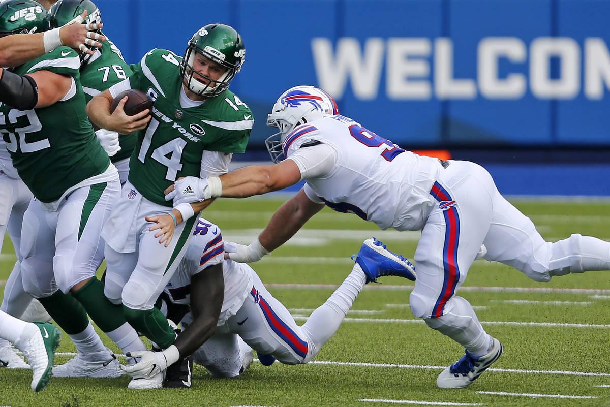 New York Jets quarterback Sam Darnold (14) is sacked by Buffalo Bills defensive end Mario Addis ...