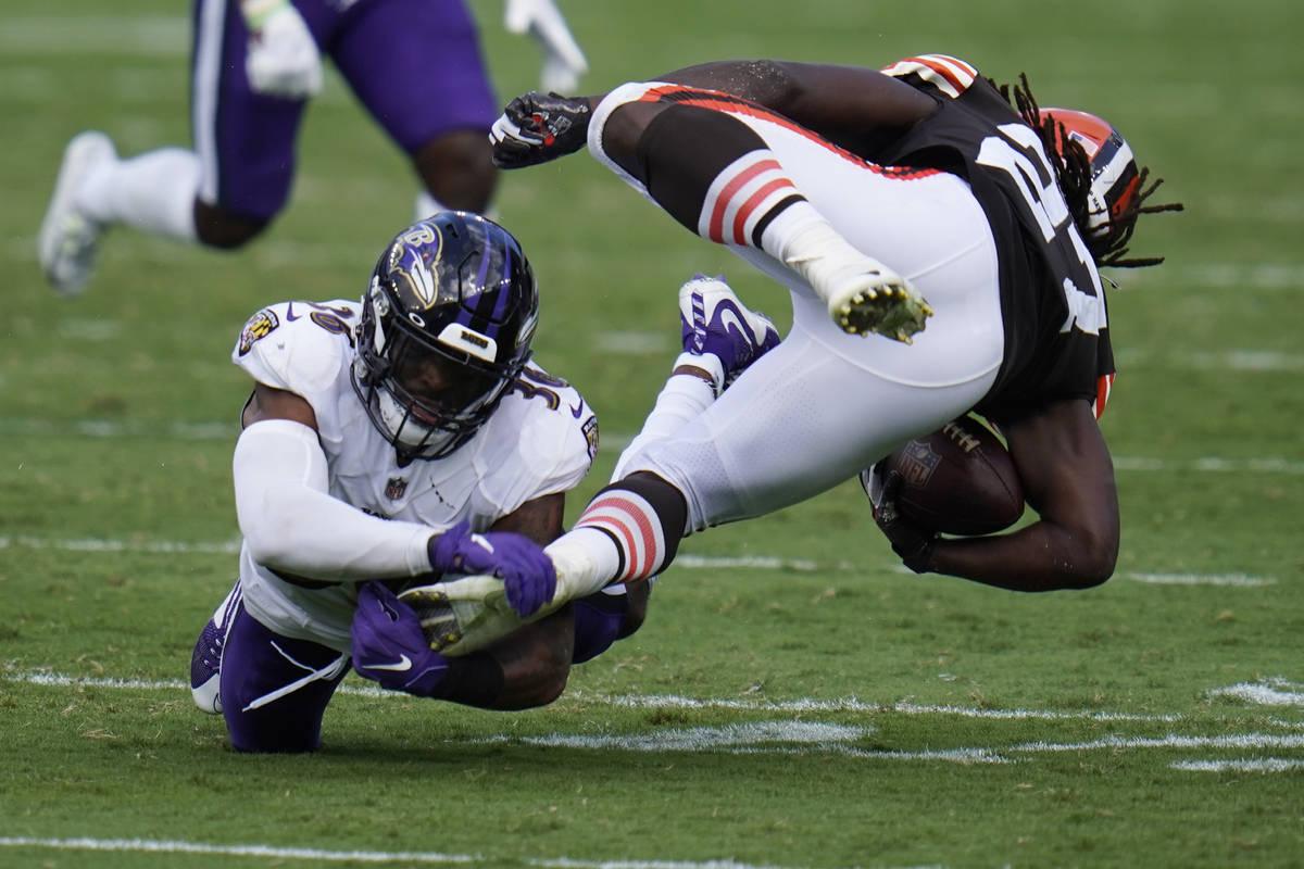 Baltimore Ravens safety Chuck Clark (36) grabs Cleveland Browns running back Kareem Hunt's (27) ...