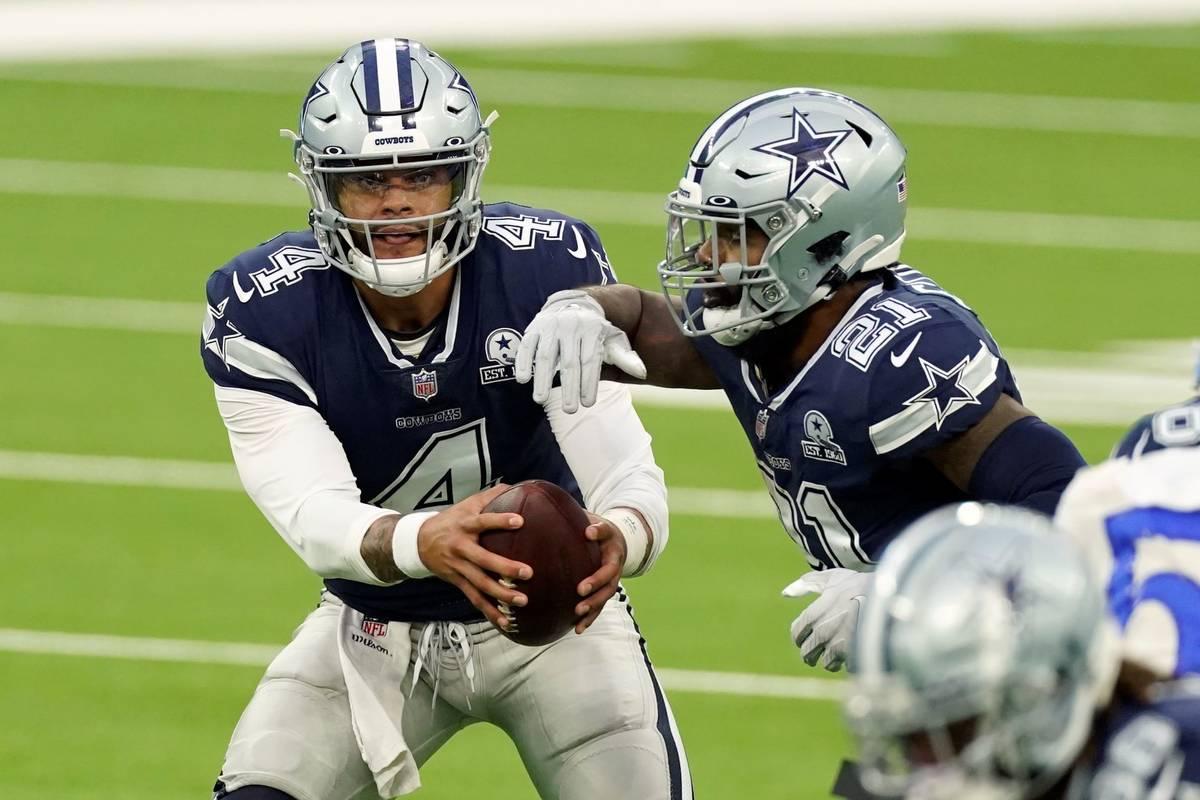 Dallas Cowboys quarterback Dak Prescott (4) fakes a handoff to running back Ezekiel Elliott (21 ...