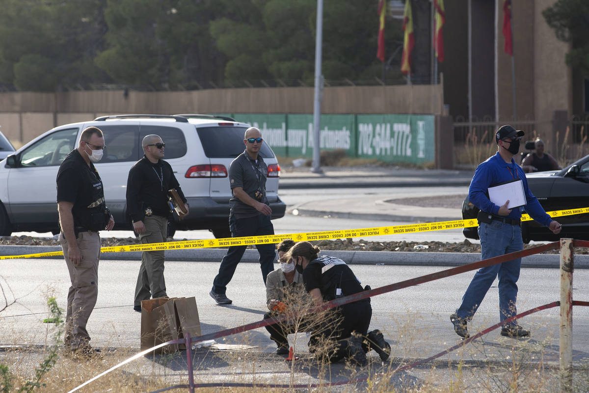 Las Vegas police collect evidence while investigating the homicide of a juvenile near the inter ...