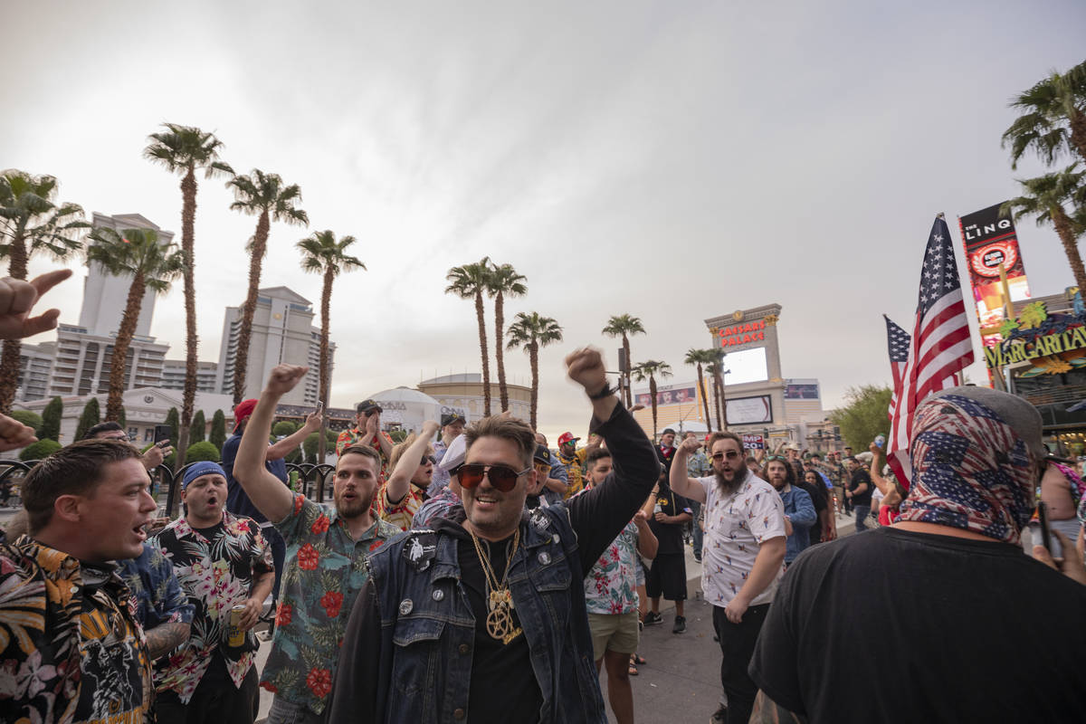 """Individuals chant """"Four more years,"""" on the Las Vegas Strip on Friday, Sept. 11, 2020. (Eli ..."""