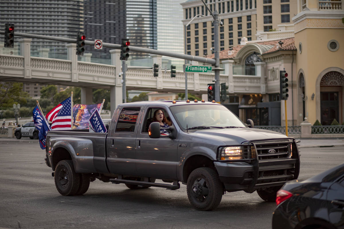 A truck participating in a caravan rally for Make Nevada Red, and Fight for Nevada, drives down ...