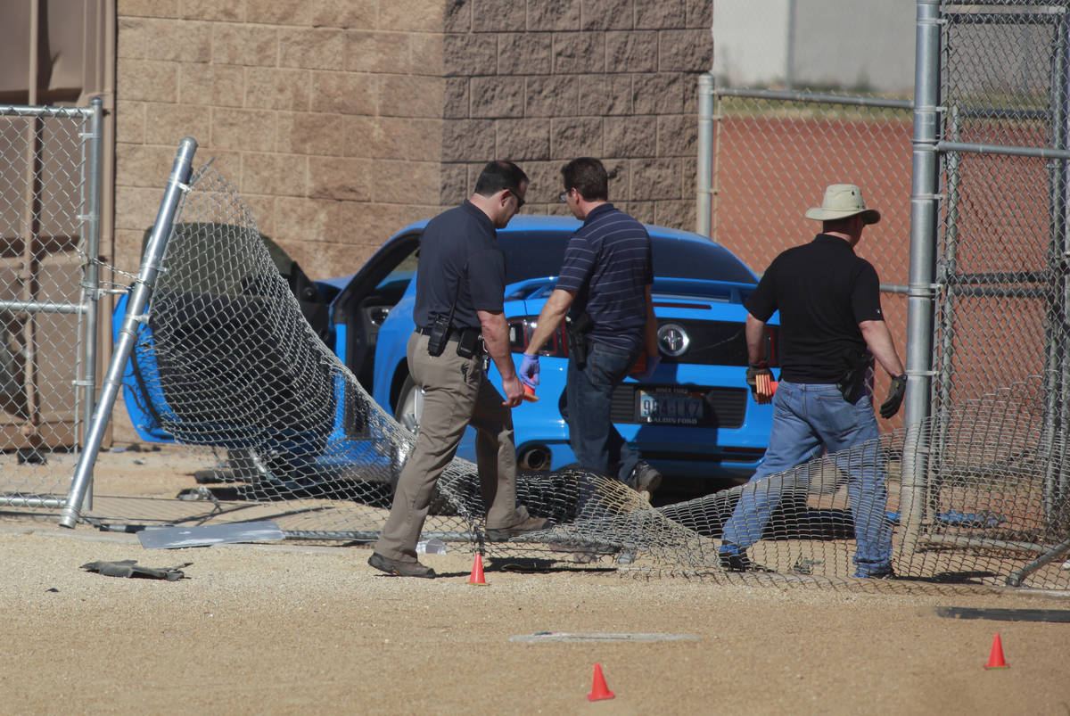 Las Vegas police investigate a suspected street-racing crash Feb. 9 involving two vehicles, one ...