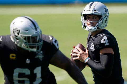 Las Vegas Raiders quarterback Derek Carr looks to pass during the second half of an NFL footbal ...