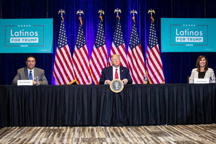 President Donald Trump addresses the Latinos for Trump roundtable next to Jesus Marquez, left, ...