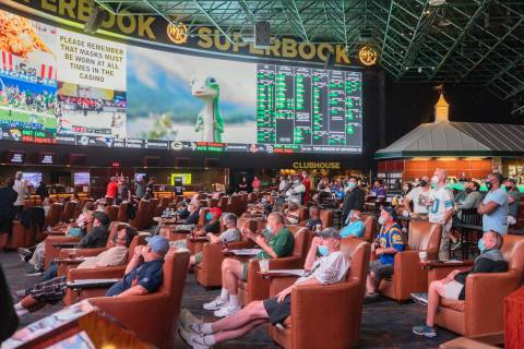 Fans watch the opening weekend of the NFL at the Westgate Sportsbook in Las Vegas on Sunday, Se ...
