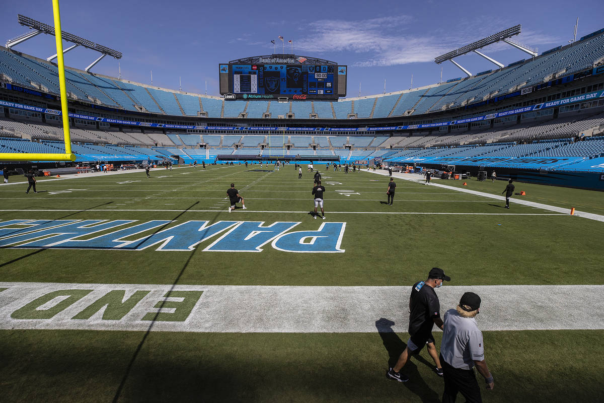 The Las Vegas Raiders warm up before the start of their NFL football game with the Carolina Pan ...