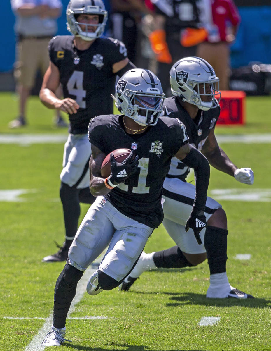 Las Vegas Raiders wide receiver Henry Ruggs III (11) runs with the football on a reverse from L ...