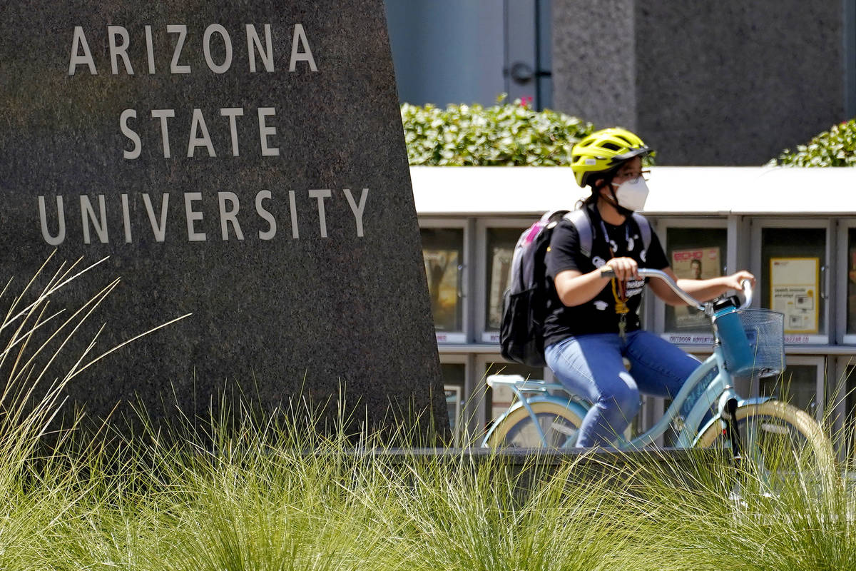 FILE--A cyclist crosses an intersection on the campus of Arizona State University on Tuesday, S ...