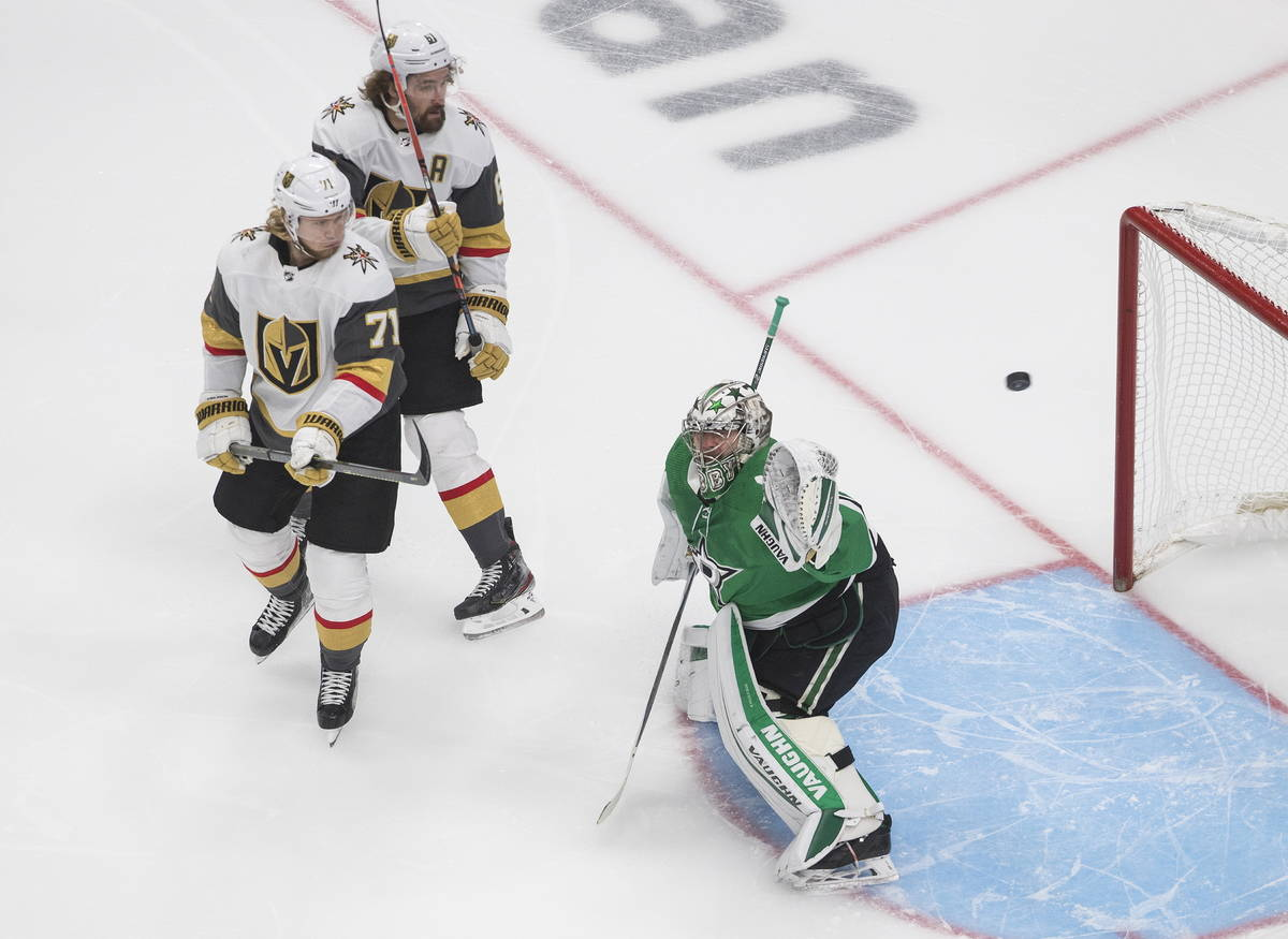 Dallas Stars goalie Anton Khudobin makes a save as Vegas Golden Knights' William Karlsson (71) ...