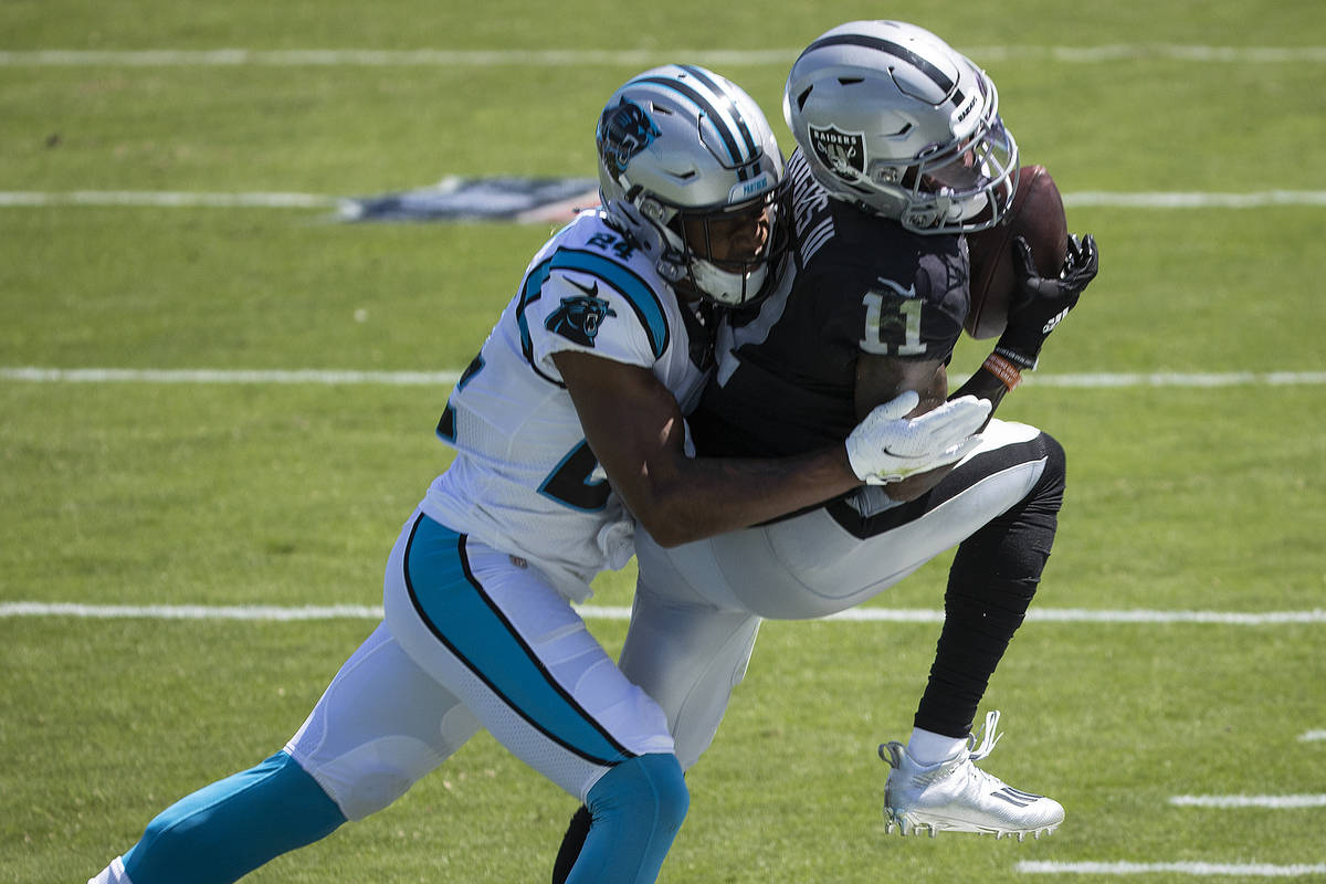 Las Vegas Raiders wide receiver Henry Ruggs III (11) fights for a reception with Carolina Panth ...