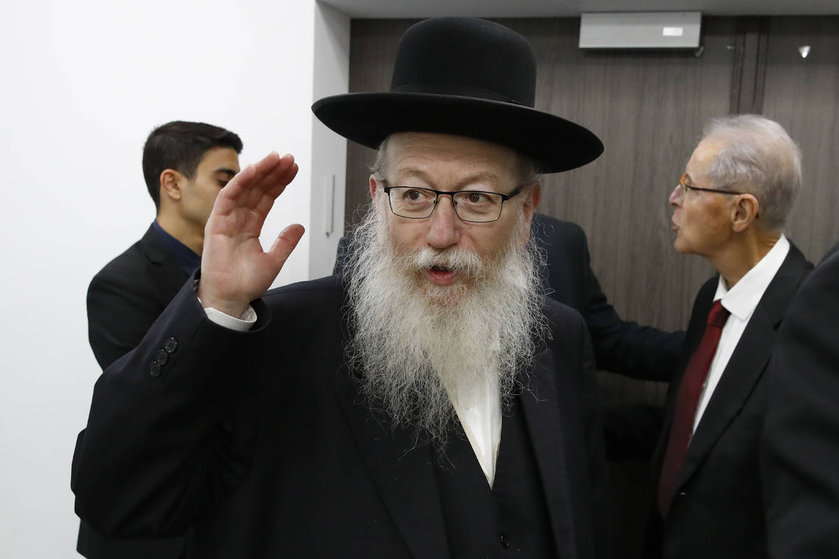 FILE - In this Feb. 23, 2020 file photo, Israeli Health Minister Yaakov Litzman arrives for a s ...