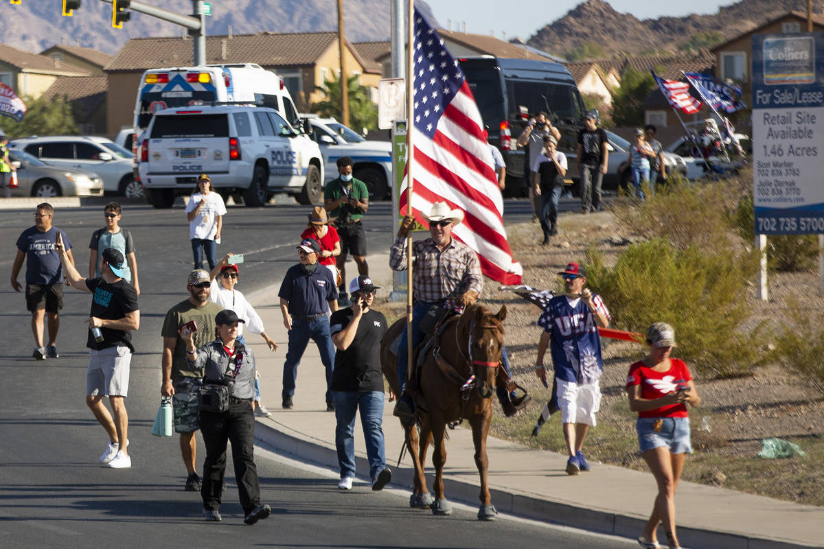 One man rides in on horseback to wait in line for President Donald Trump's campaign rally at Xt ...