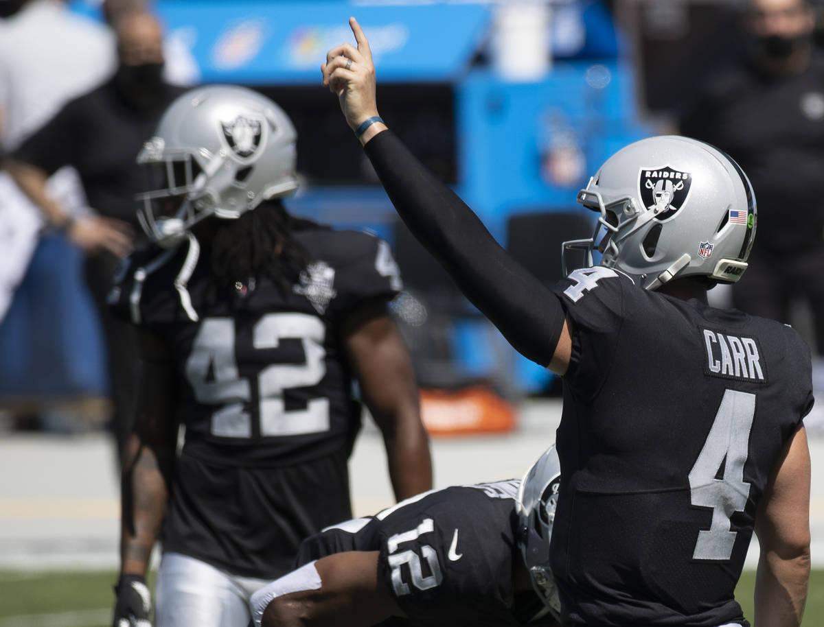 Las Vegas Raiders quarterback Derek Carr (4) warms up before the start of an NFL football game ...