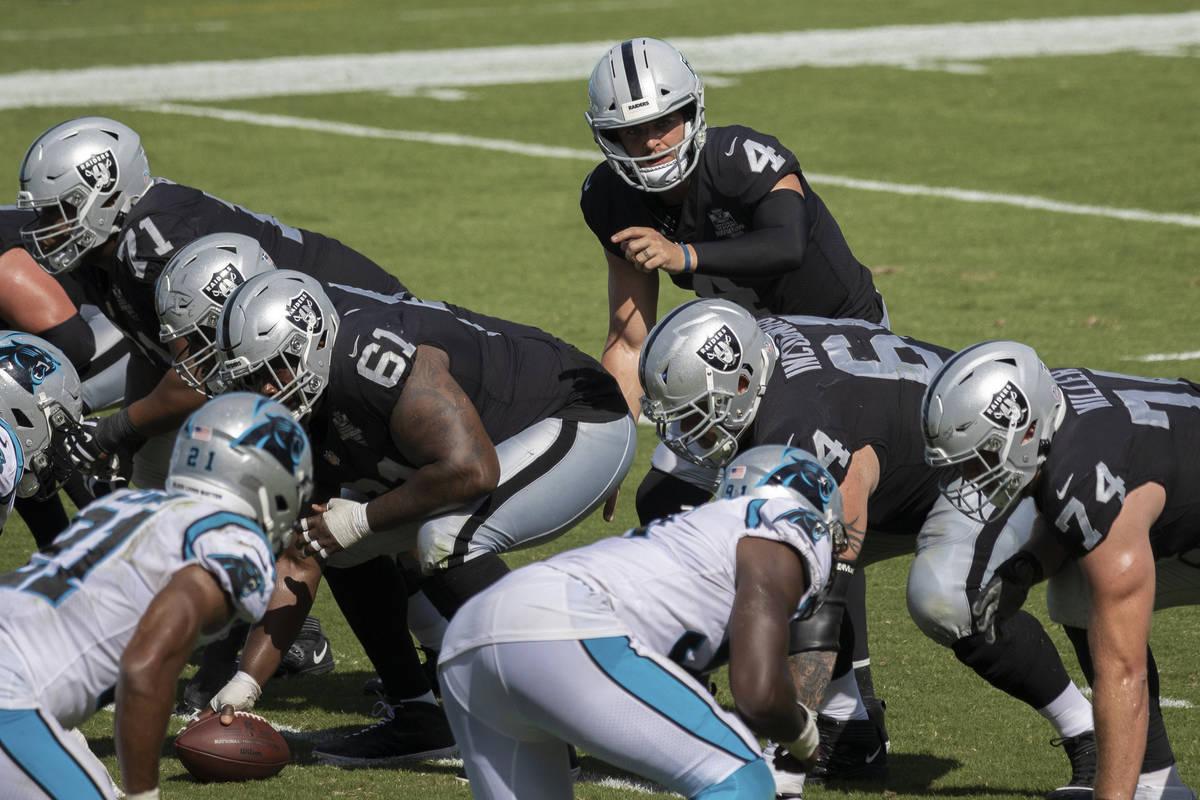 Las Vegas Raiders quarterback Derek Carr (4) calls an audible during the second half of an NFL ...