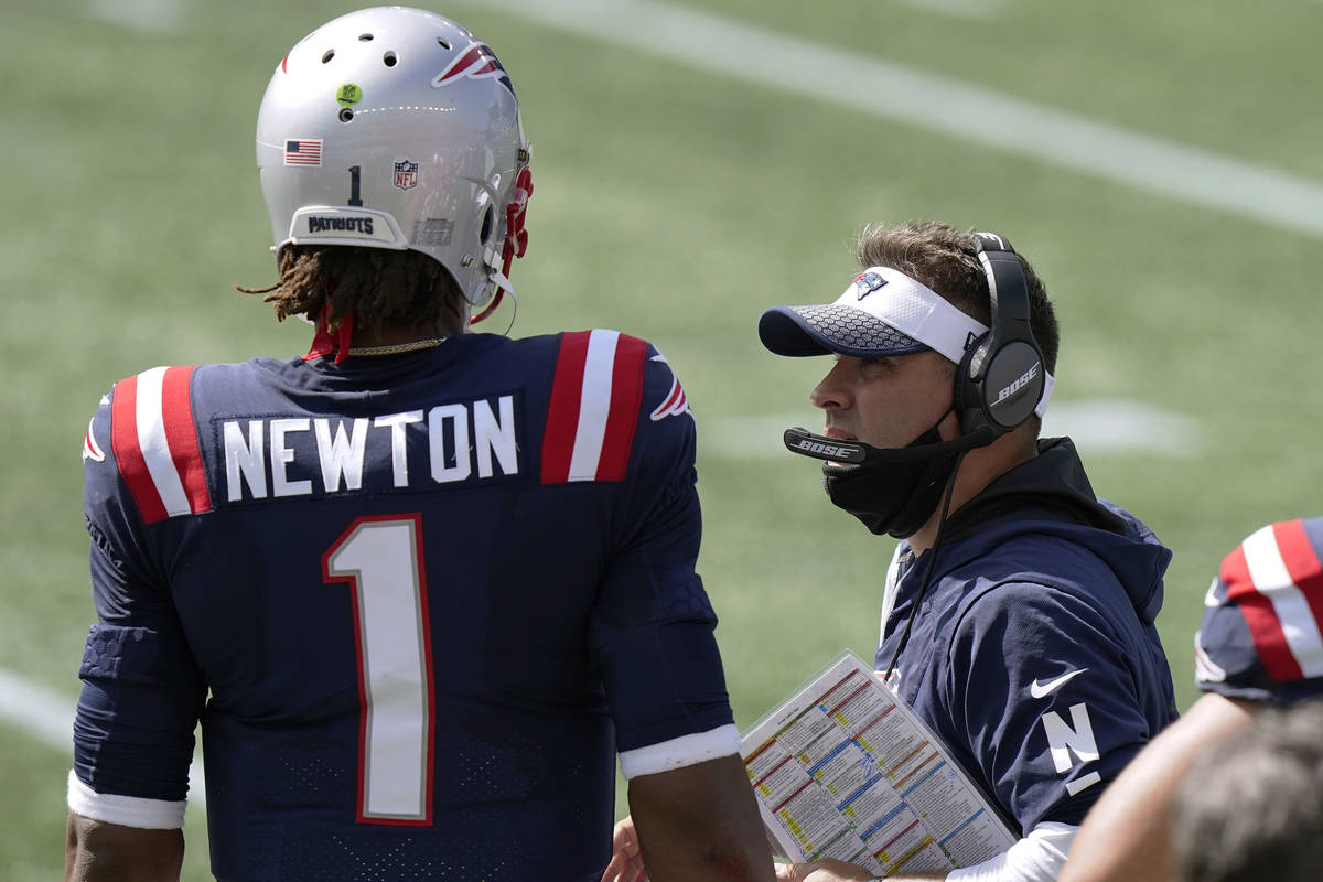New England Patriots offensive coordinator Josh McDaniels, right, speaks to quarterback Cam New ...
