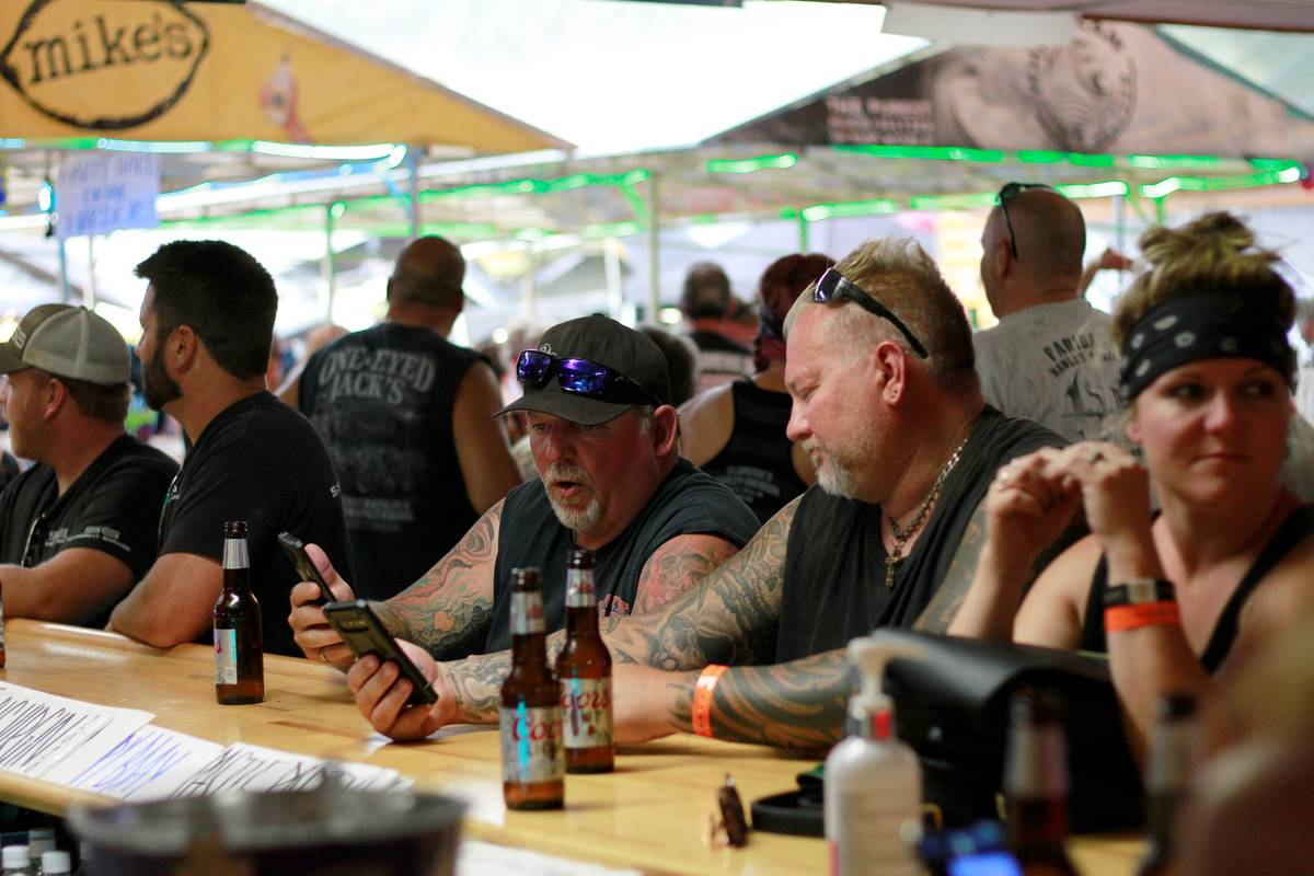 People congregate at One-Eyed Jack's Saloon during the 80th annual Sturgis Motorcycle Rally in ...