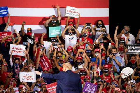 President Donald Trump waves and points while leaving the stage after speaking at a campaign ra ...