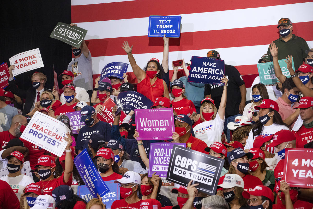 The crowd cheers while waiting for President Donald Trump to take the stage at a campaign rally ...