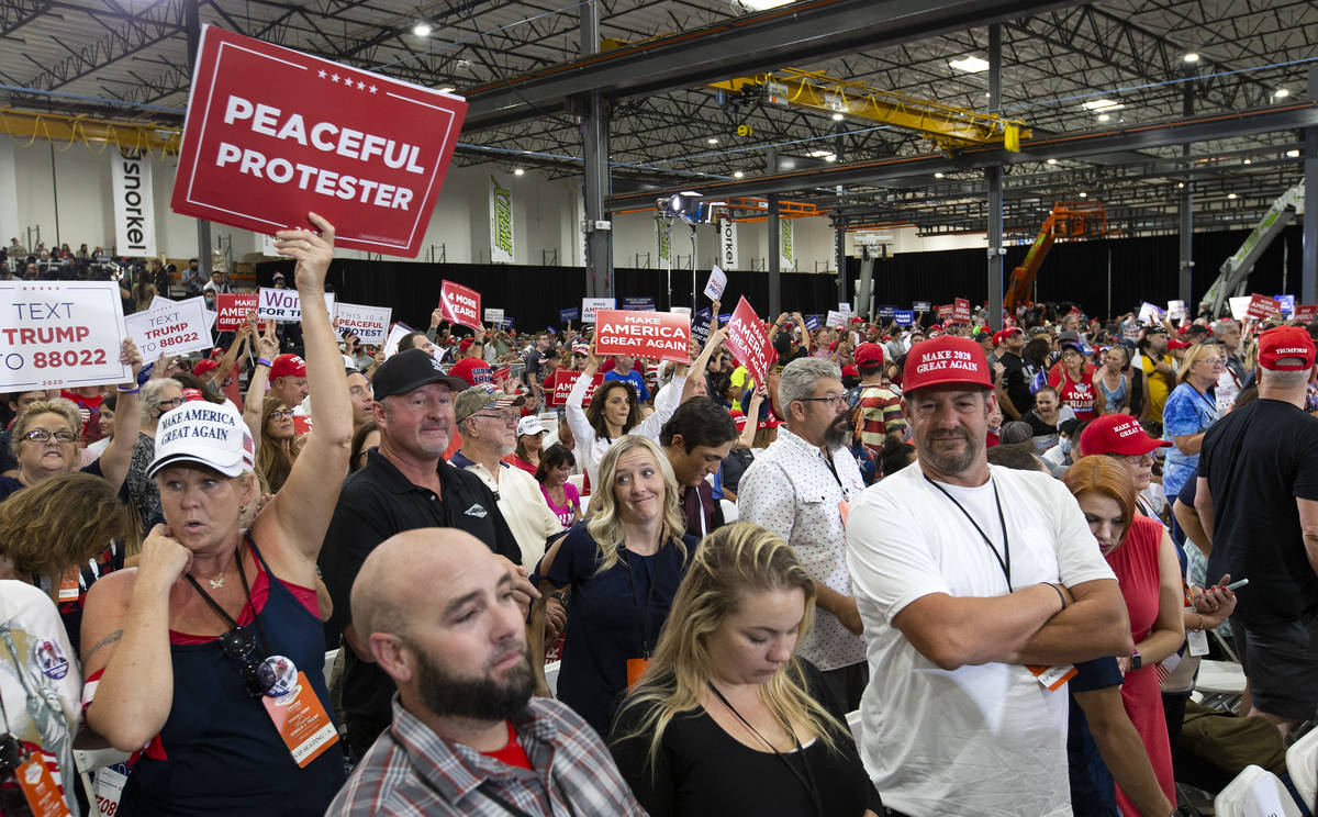 The crowd cheers during a Trump campaign rally at Xtreme Manufacturing on Sunday, Sept. 13, 202 ...