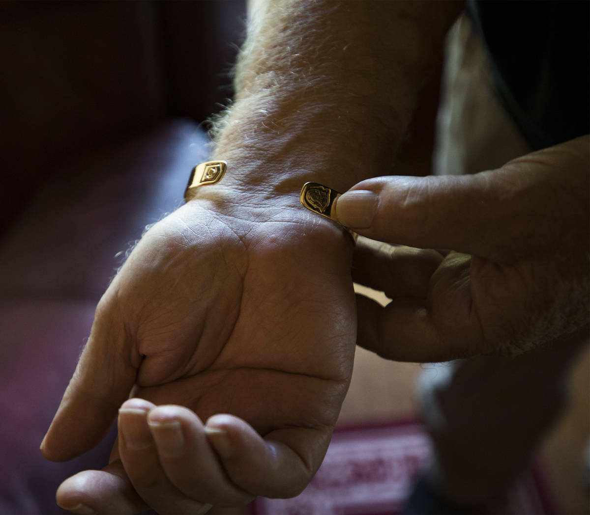 """James """"Bo"""" Gritz, a former U.S. Army Special Forces officer, shows his POW/MIA bracelet at ..."""