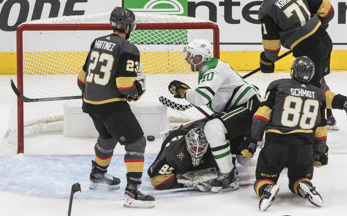 Dallas Stars' Corey Perry (10) reacts as the puck goes into the net past Vegas Golden Knights g ...