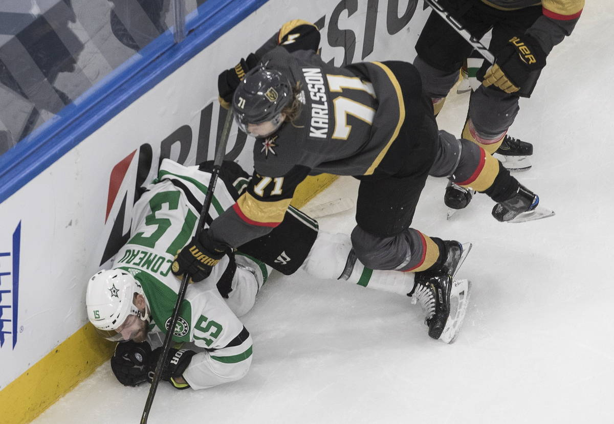 Dallas Stars' Blake Comeau (15) is checked by Vegas Golden Knights' William Karlsson (71) durin ...