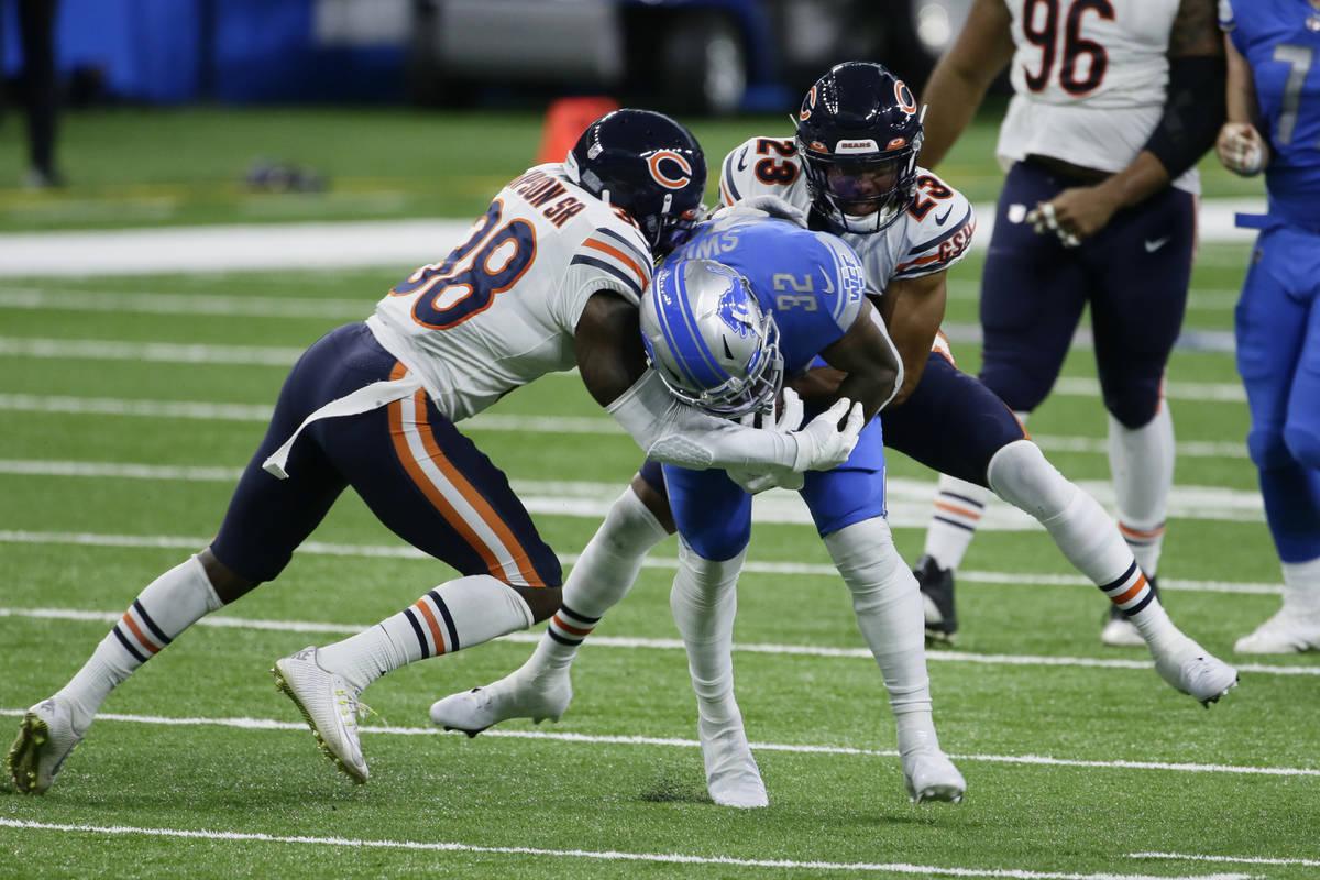 Chicago Bears free safety Tashaun Gipson (38) and cornerback Kyle Fuller (23) tackle Detroit Li ...