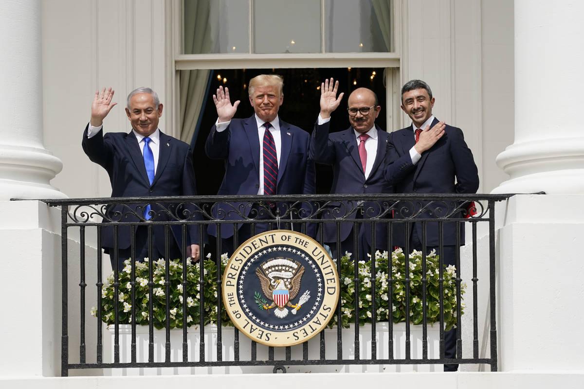From left, Israeli Prime Minister Benjamin Netanyahu, President Donald Trump, Bahrain Foreign M ...