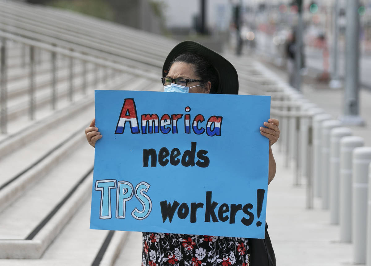 Mirna Rodriguez holds a sign as Temporary Protective Status (TPS) holders and community partner ...