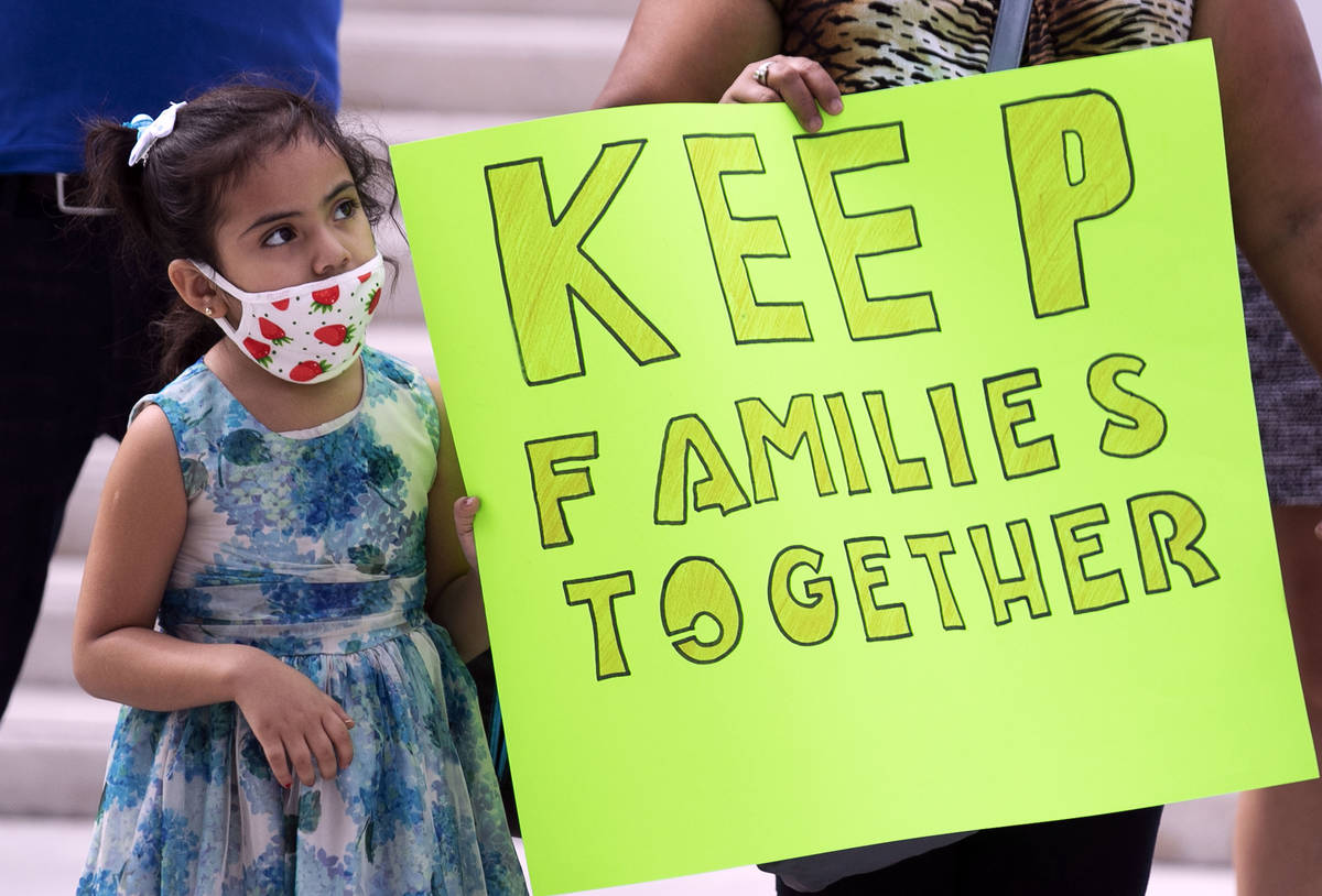 Daniella Rivera, 5, watches as Temporary Protective Status (TPS) holders and community partners ...
