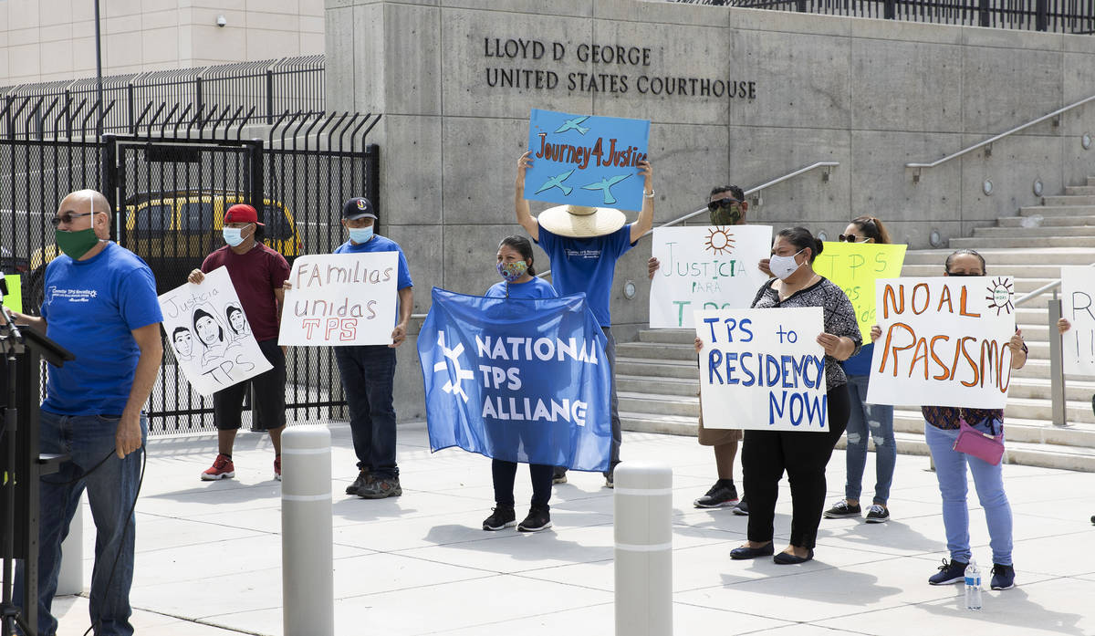 Miguel Barahona, left, member of the TPS committee of Las Vegas, speaks as Temporary Protective ...