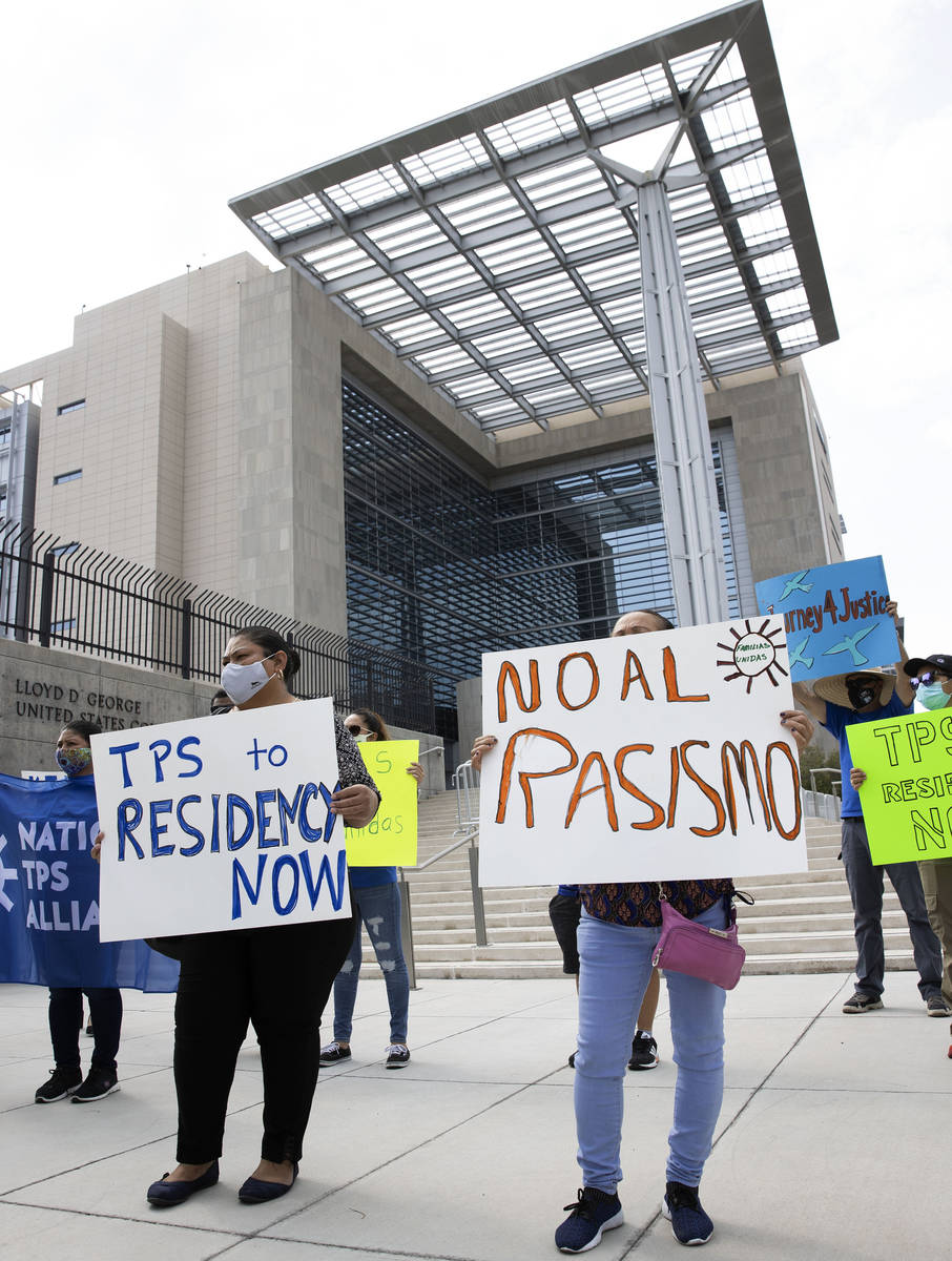 Temporary Protective Status (TPS) holders and community partners protest outside of Lloyd Georg ...