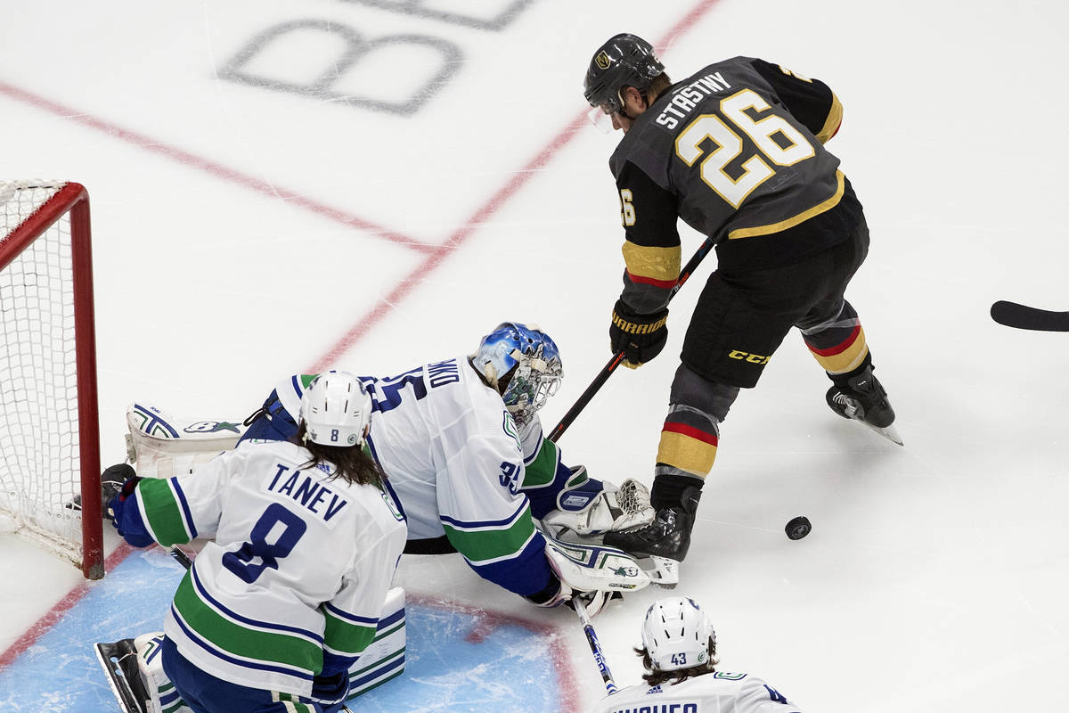 Vancouver Canucks goalie Thatcher Demko (35) makes a save against Vegas Golden Knights' Paul St ...
