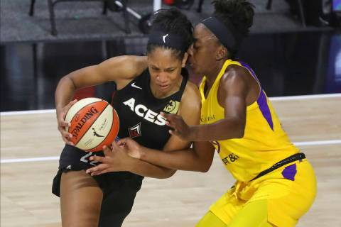 Las Vegas Aces' A'ja Wilson, left, drives against Los Angeles Sparks' Nneka Ogwumike during the ...