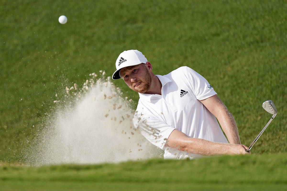 Daniel Berger hits from a greenside bunker on the 18th hole during the first round of play in t ...
