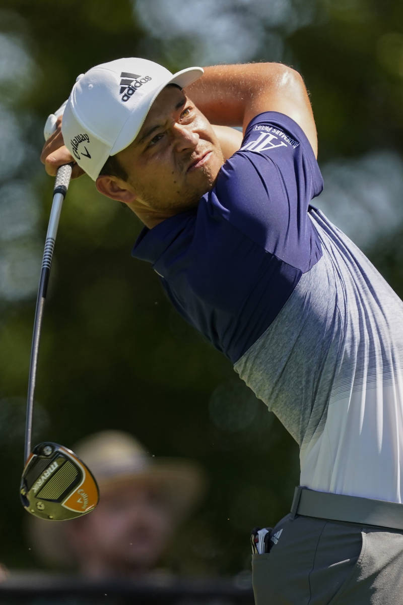 Xander Schauffele hits his tee shot on the third hole during the final round of the Tour Champi ...