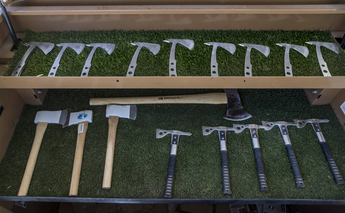 A variety of axes are ready for throwing at Adrenaline Mountain, which offers numerous extreme ...