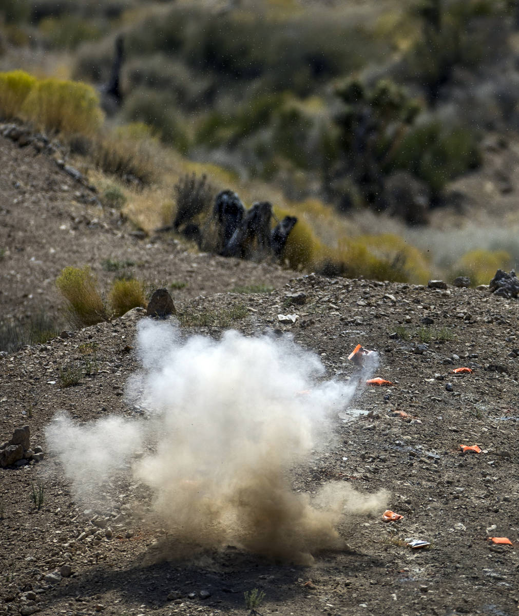 An explosive target blows up on the Adrenaline Mountain gun range, Thursday, Sept. 10, 2020, in ...