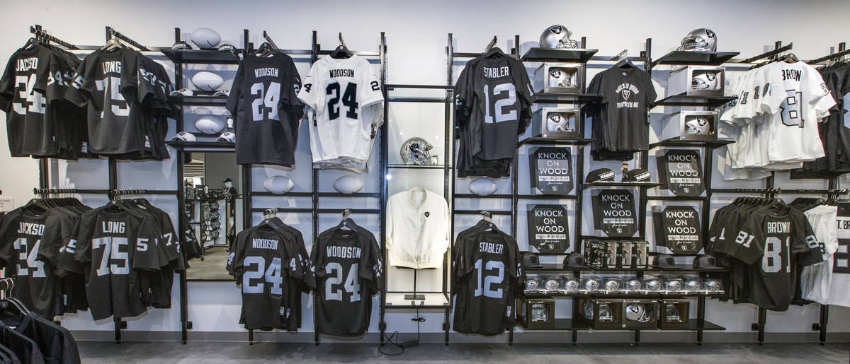Classic player jerseys for sale flank an original Al Davis jacket within The Raider Image offic ...