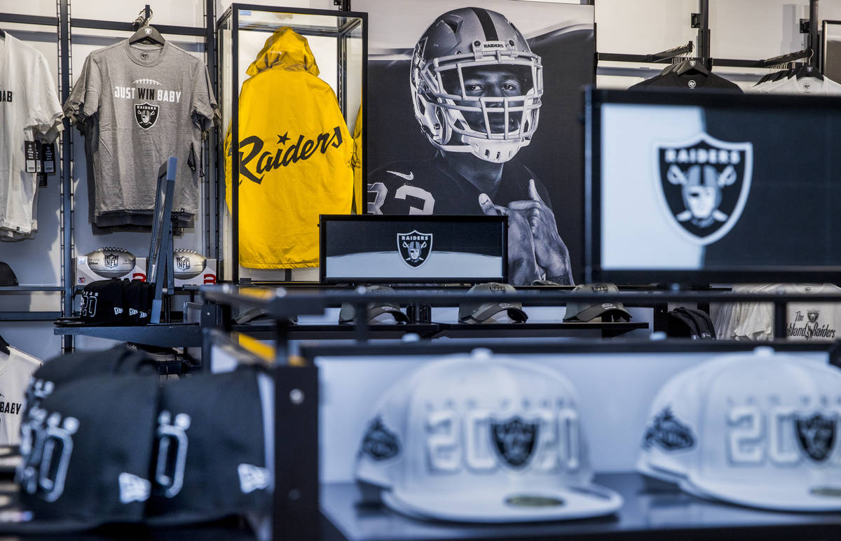 A classic gold and black RaiderÕs jacket is on display amongst merchandise to purchase at ...